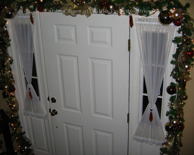 Garland around front doorWM