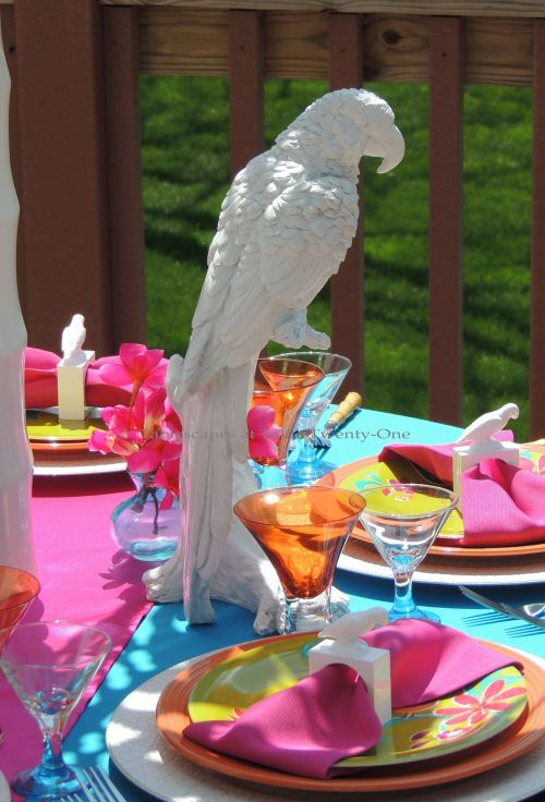 Tablescapes at Table Twenty-One: Tropical-themed tablescape with white Z Gallerie parrots as part of the centerpiece