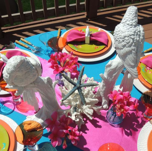 Tablescapes at Table Twenty-One: Mid-priced tropical-themed centerpiece with white parrots from Z Gallerie, white coral, blue starfish and fuchsia plumeria