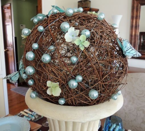 """Tablescapes at Table Twenty-One: Float Like a Butterfly - Grapevine ball wrapped in Oasis MEGA Beaded wire in """"Ice Blue"""", dotted with hydrangea blooms and butterflies"""