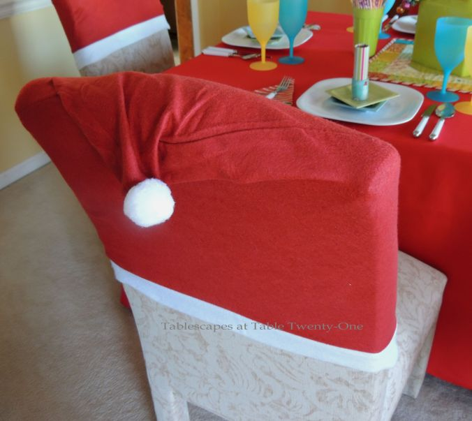Tablescapes at Table Twenty-One, Kaleidoscope Christmas - Multi-Color Kids' Tablescape: Santa hats from Dollar Tree on dining chairs