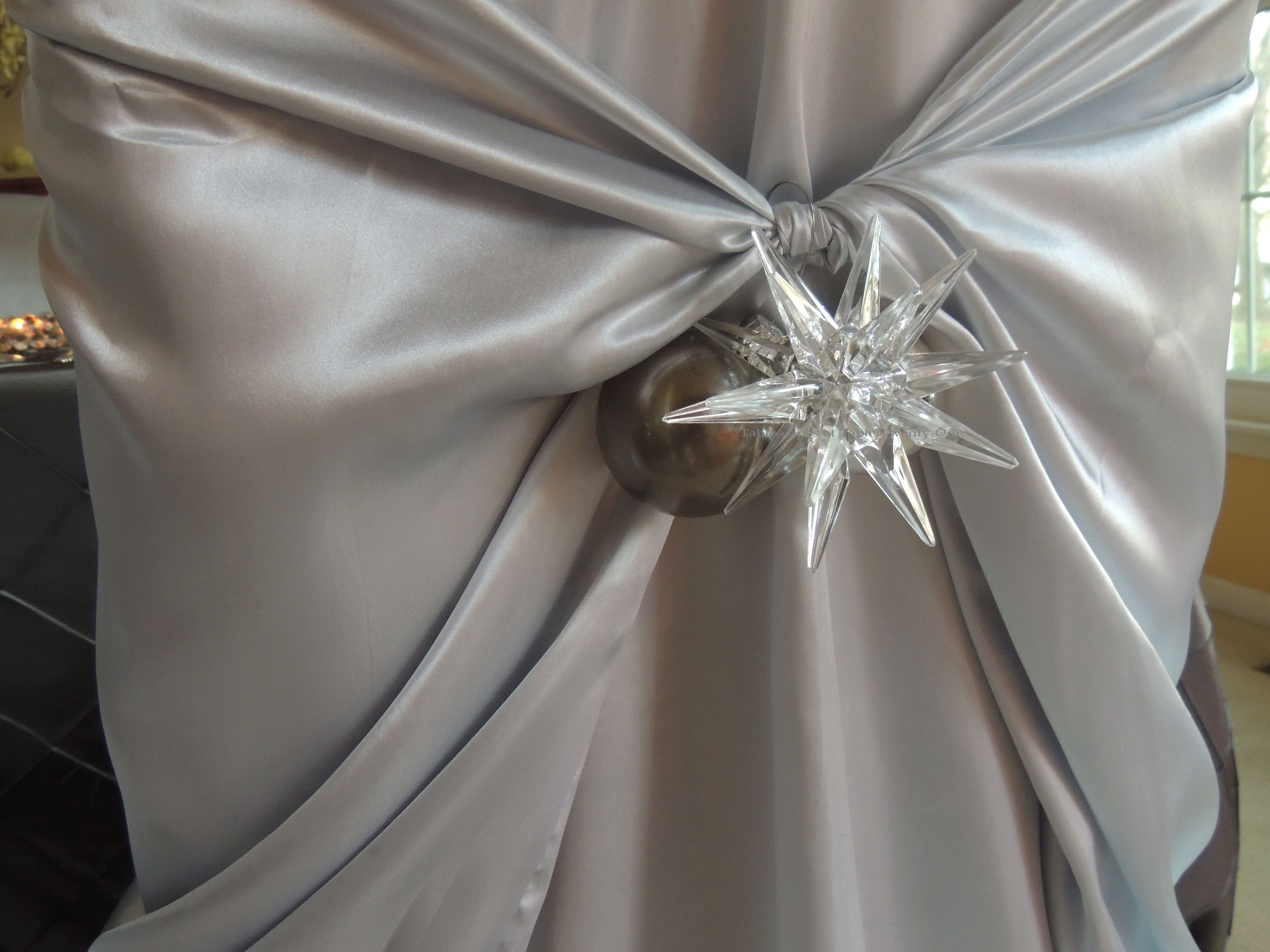 Tablescapes at Table Twenty-One, Platinum New Year's Eve Wedding: Dining chair ornament embellishment