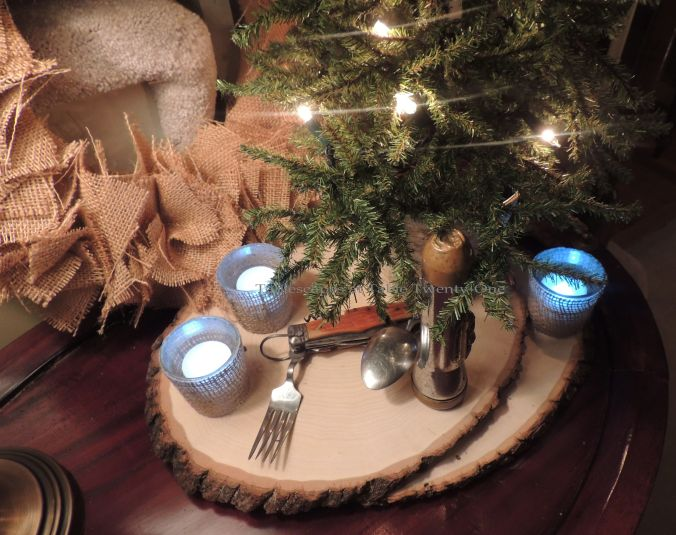 Tablescapes at Table Twenty-One, 'Twas the Night Before Christmas: Burlap wreath, wood slices, Swiss Army camping gear