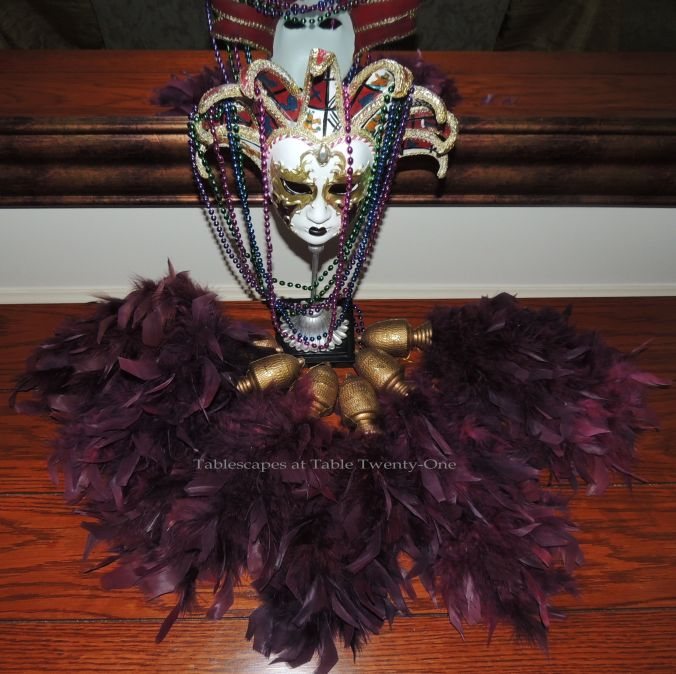 Tablescapes at Table Twenty-One, www.tabletwentyone.wordpress.com: Celebrate Mardi Gras! - Buffet mask surrounded in feathered tassels