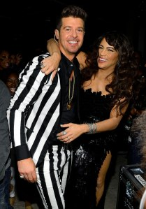 INSPIRATION: Singer Robin' Thicke's black & white striped suit worn  during his infamous performance with Miley Cyrus at the 2013 Billboard Music Awards. (shown here with wife Paula Patton)