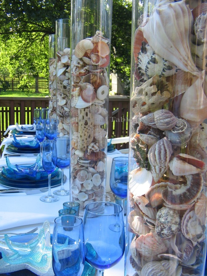 Tablescapes at Table Twenty-One, www.tabletwentyone.wordpress.com, Ocean Blue – Starfish & Seashells:  seashells in multiple tall glass cylinders