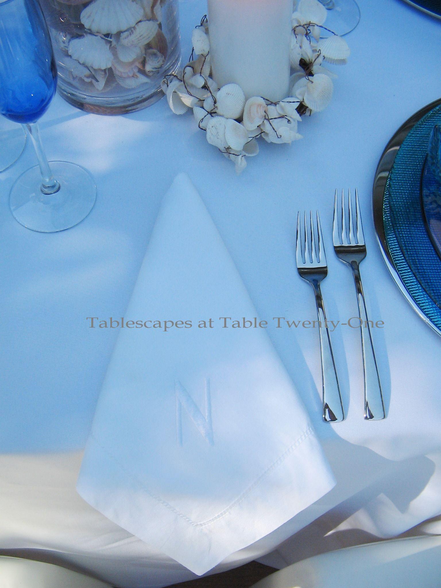 Tablescapes at Table Twenty-One, www.tabletwentyone.wordpress.com, Ocean Blue – Starfish & Seashells:  White cotton napkin with initial