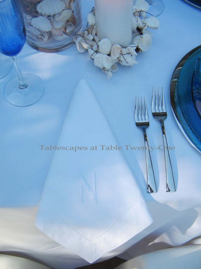 Tablescapes at Table Twenty-One, www.tabletwentyone.wordpress.com, Ocean Blue – Starfish & Seashells:  White cotton napkin with initial