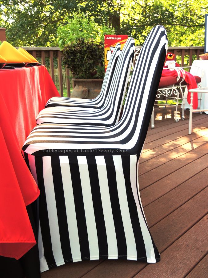 Tablescapes at Table Twenty-One, www.tabletwentyone.wordpress.com, Chiefs Pride: Chairs with black & white striped stretch chair covers from LinenTablecloth.com