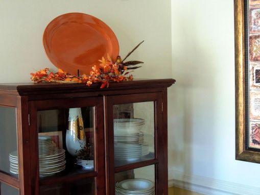 Alycia Nichols, Tablescapes at Table Twenty-One, www.tabletwentyone.wordpress.com, Pheasants & Pumpkins: bittersweet & pheasant feather arrangement on china cabinet