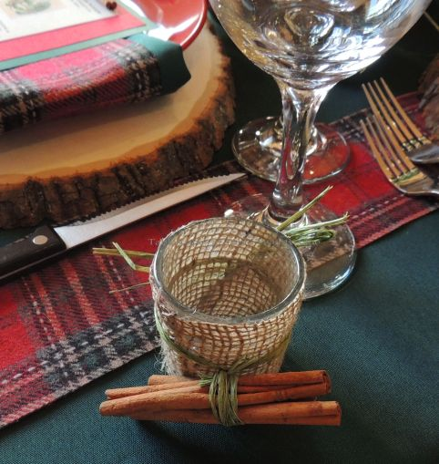 "Alycia Nichols, Tablescapes at Table Twenty-One, www.tabletwentyone.wordpress.com, ""Christmas in the Woods"": Burlap-wrapped votive tied with cinnamon sticks"
