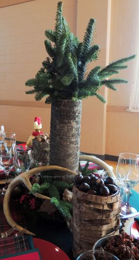 """Alycia Nichols, Tablescapes at Table Twenty-One, www.tabletwentyone.wordpress.com, """"Christmas in the Woods"""": Centerpiece with bark-covered vase, antlers, woodland creatures"""