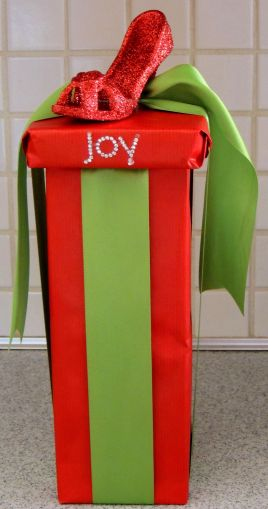 Alycia Nichols, Tablescapes at Table Twenty-One, www.tabletwentyone.wordpress.com, Cardinal Christmas: Gift wrapped in red & lime green with red high heel shoe ornament affixed to the top