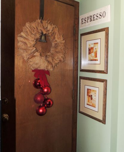 "Alycia Nichols, Tablescapes at Table Twenty-One, www.tabletwentyone.wordpress.com, ""Timberland Christmas – 2014 Christmas Décor: Burlap wreath with red ribbon and ornaments on garage door"