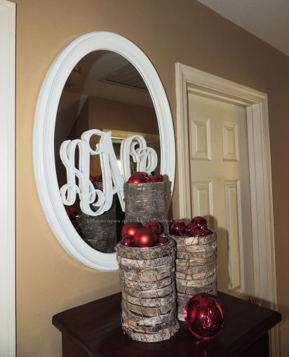 "Alycia Nichols, Tablescapes at Table Twenty-One, www.tabletwentyone.wordpress.com, ""Timberland Christmas – 2014 Christmas Décor: Red Christmas ornaments in bark-wrapped cylinders, wood monogrammed mirror"