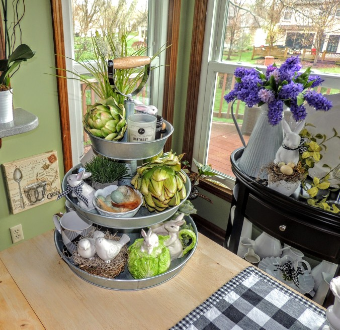 3-tier galvanized stand outfitted for Easter with nests, bunnies, faux artichokes, grass & hyacinth. www.tabletwentyone.wordpress.com