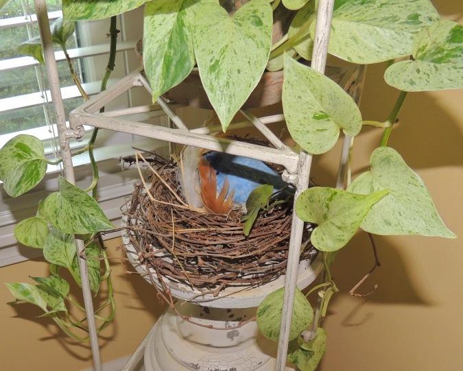 Bluebird in nest on tiered stand. www.tabletwentyone.wordpress.com