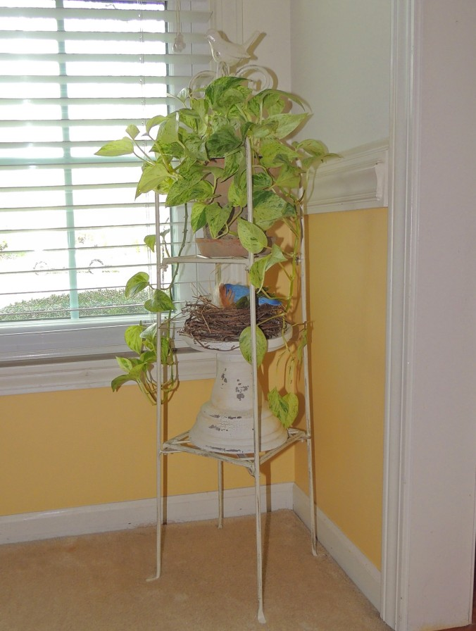 Spring vignette on ivory wrought iron tiered stand. www.tabletwentyone.wordpress.com