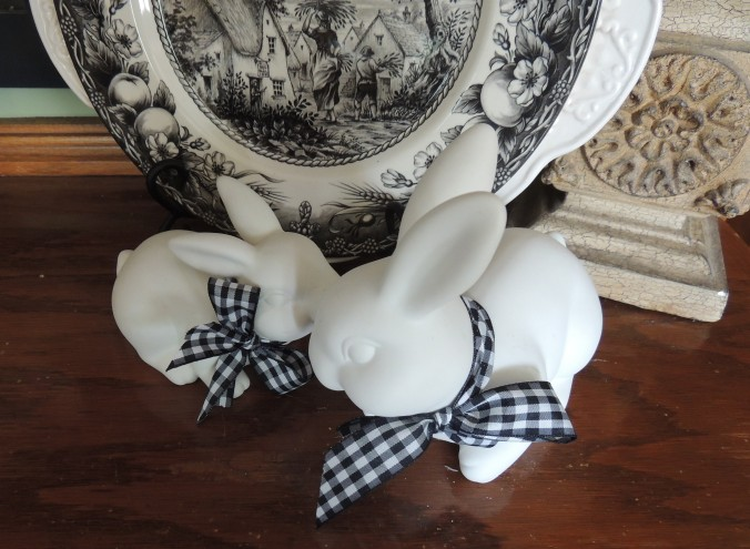 White bunnies with black & white gingham check neck bows in front of black & white transferware. www.tabletwentyone.wordpress.com