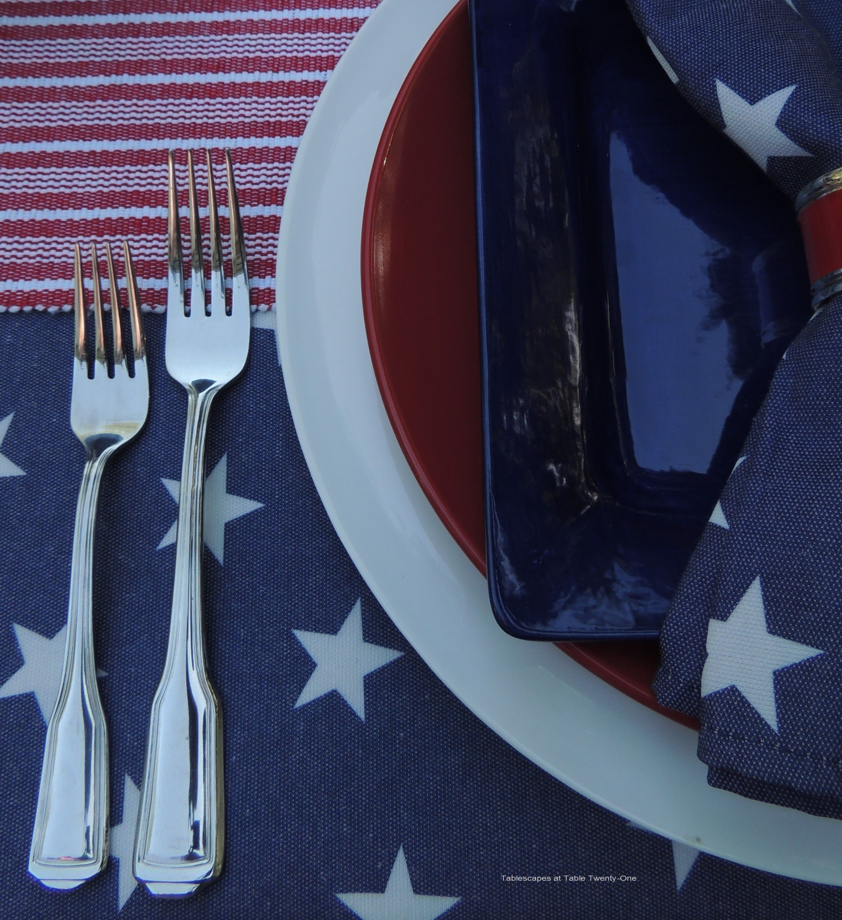 ... Settings Are Created By Using A White Ceramic Charger From Old Time  Pottery Topped With A Red Dinner Plate And Square Blue Salad Plate From Pier  1.